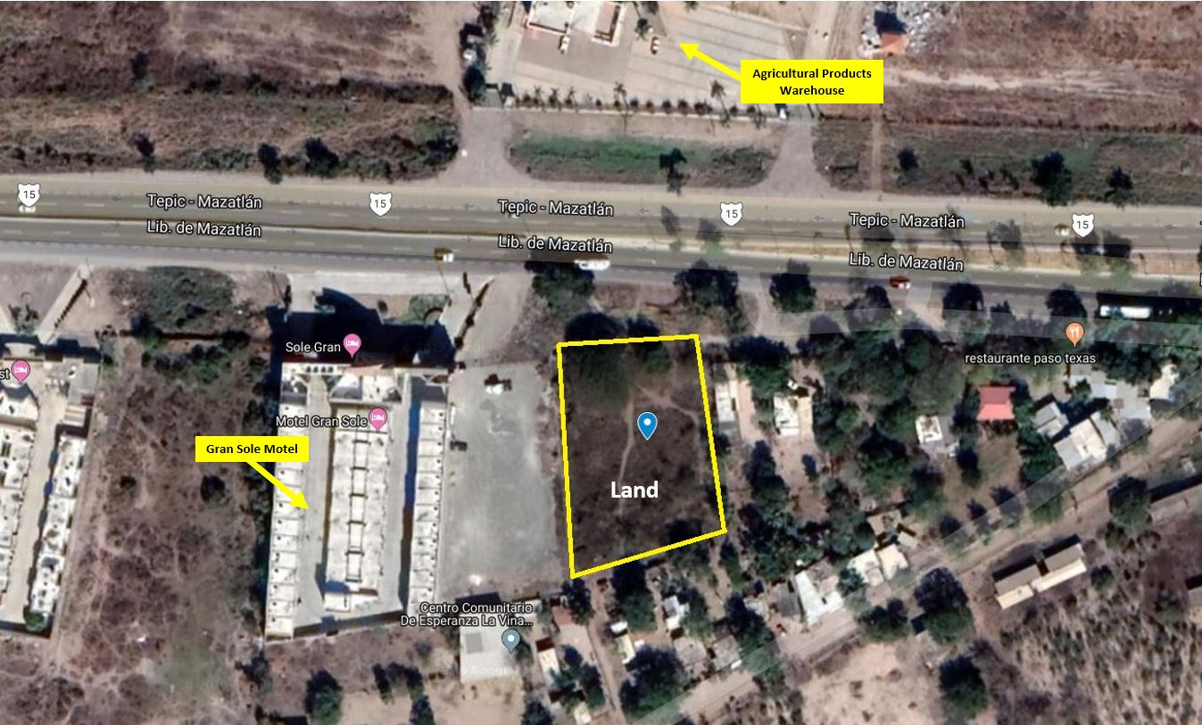 Commercial land located right on the highway close to the airport